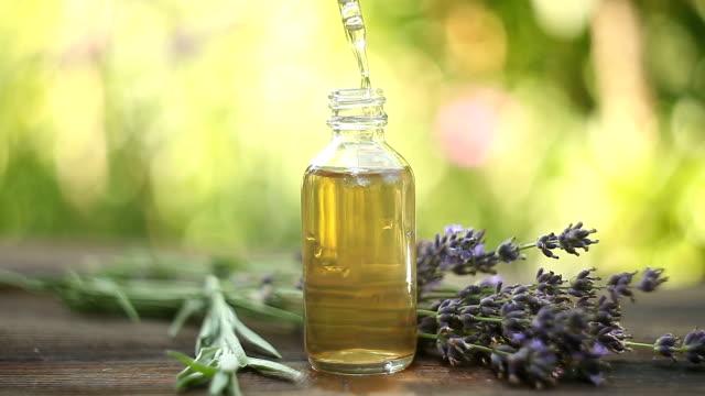 lavender essential oil in  beautiful bottle on tablel