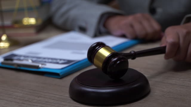 Law justice litigation concept with gavel and hammer Law justice litigation concept with gavel and hammer sentencing stock videos & royalty-free footage