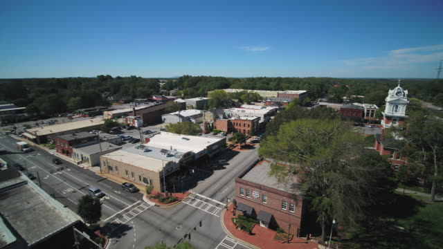 Lawrenceville Georgia Aerial v3 Flying low around city center of town and courthouse