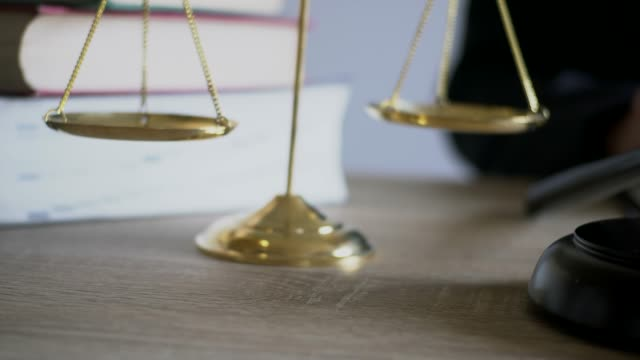 Lawyer business working with rending law book wooden gavel on table in courtroom. justice and law concept video