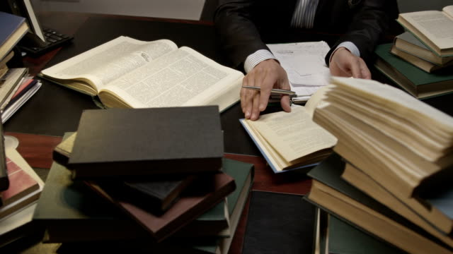 Lawyer exploring books in the working room. Shot on RED EPIC Cinema Camera.