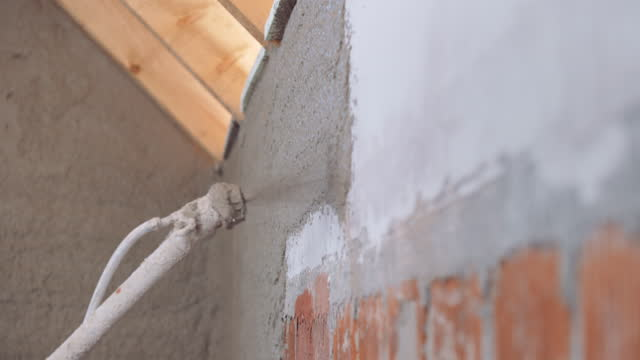 Layer of plaster sprayed onto a bare wall