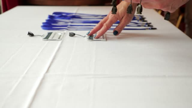 laying out lanyards - badge video stock e b–roll