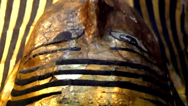 Laying statue of a golden pharoah from Egypt video