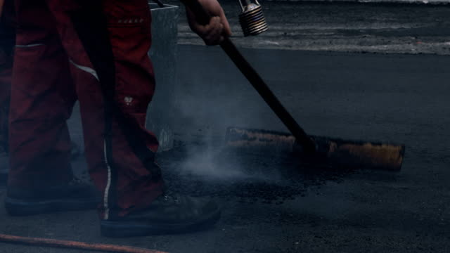 Laying Tar With a Blowtorch video