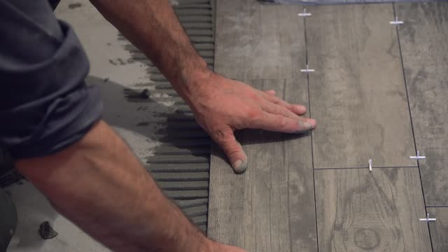 laying tile on the floor