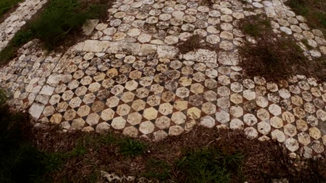 Layings of marble tiles on floor Roman agora ruins ancient town Salamis east Cyprus Famagusta video