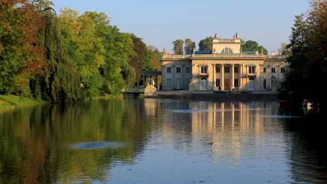 Lazienki Royal Park with the Lazienki Palace in Warsaw, Poland Panoramic view of the Lazienki Royal Park - Royal Baths Park - with the classicist Lazienki Palace, known also as Palace on the Water or Palace in the Isle in Warsaw, Poland palace stock videos & royalty-free footage