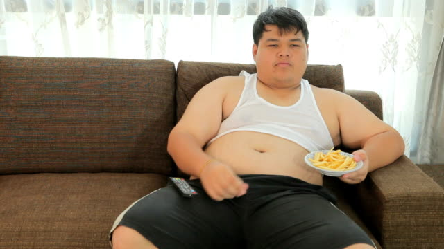 Lazy overweight male sitting with fast food video