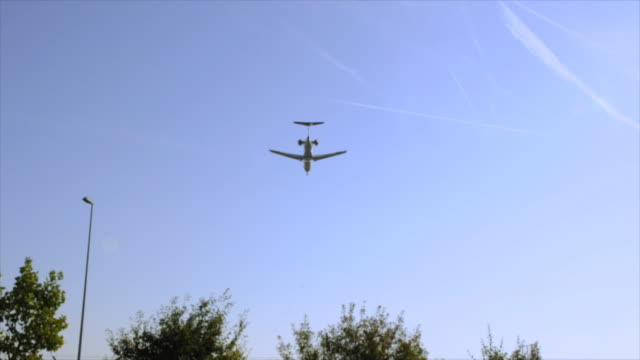 Learjet or corporate jet landing at sunrise, pan shot video