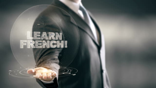 Learn French Hologram Concept Businessman Holding in Hand video