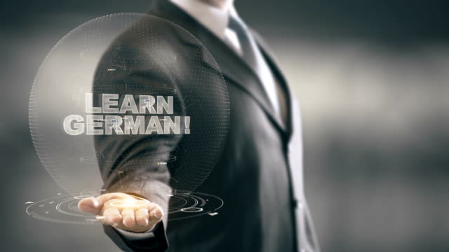 Learn German Hologram Concept Businessman Holding in Hand video