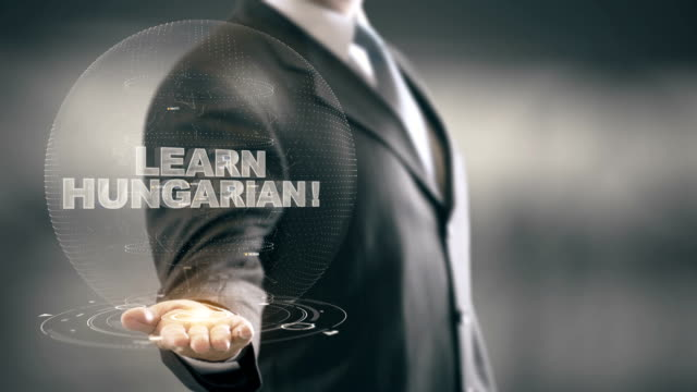 Learn Hungarian Hologram Concept Businessman Holding in Hand video