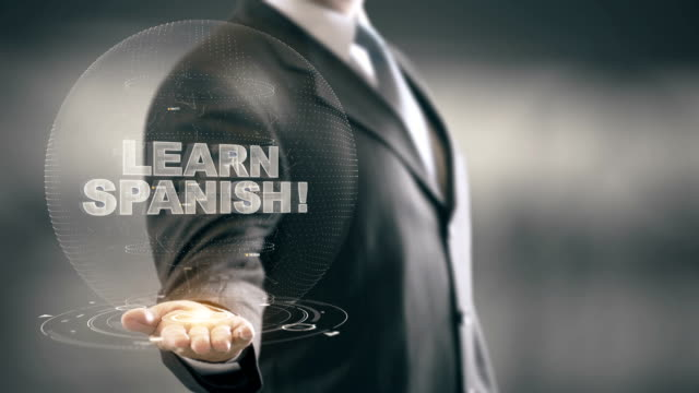 Learn Spanish Hologram Concept Businessman Holding in Hand - vídeo
