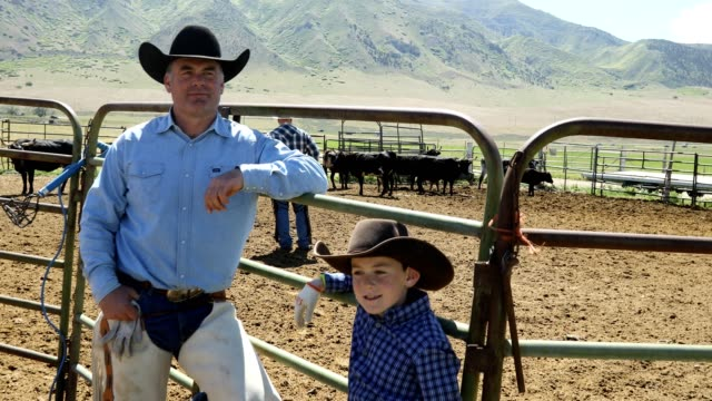 learning the ropes: father and son farm life on ranch - rancher video stock e b–roll