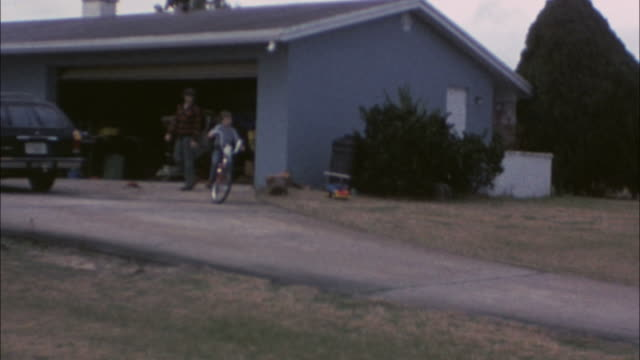 learning to ride a bike - 70's 8mm footage video