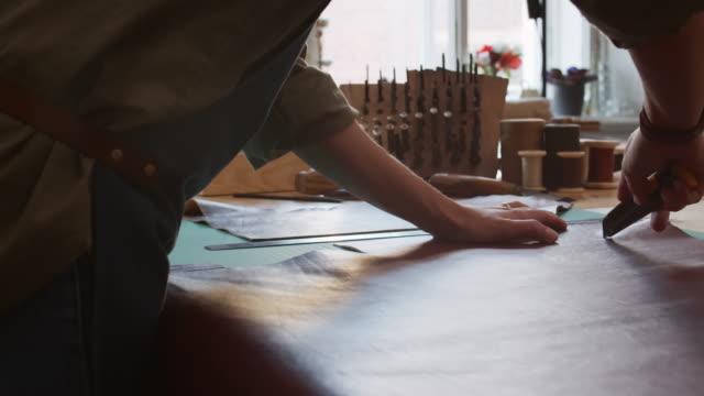 leather cutting in workshop - sarta video stock e b–roll