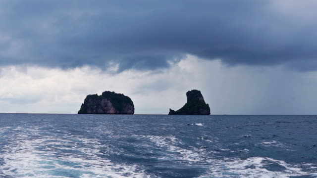 leaving bida nai and nok, phi phi by boat on stormy day - monsone video stock e b–roll