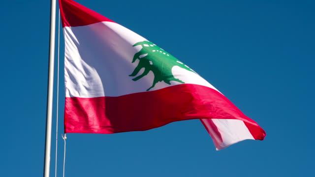 stockvideo's en b-roll-footage met libanese vlag verlicht door de zon - beiroet