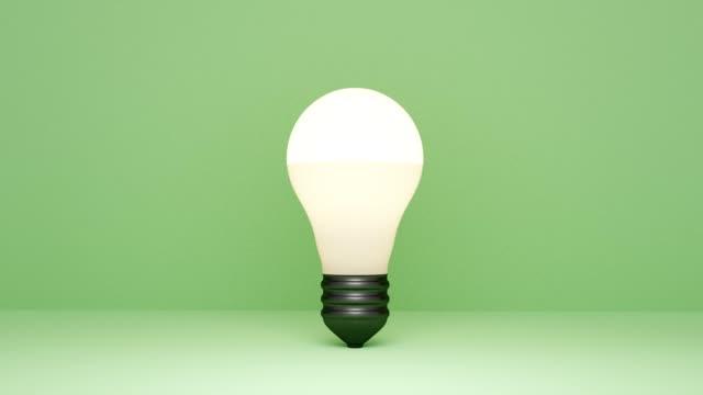 3d-geführte lampe springt und leuchtet auf - led leuchtmittel stock-videos und b-roll-filmmaterial