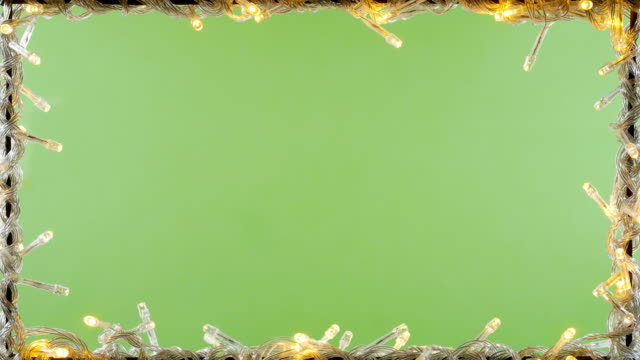 vídeos de stock e filmes b-roll de led light frame green screen background 4k - feriado