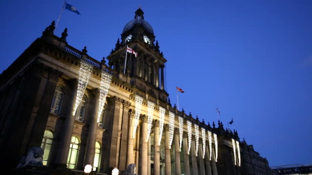 Leeds Town Hall at Night Leeds Town Hall at Night with the Yorkshire, England and Union flags flying in the breeze. Filmed in Leeds, West Yorkshire. victorian architecture stock videos & royalty-free footage