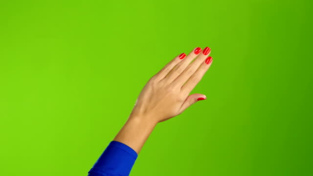 left hand is widely waving goodbye or hello. green screen - good bye stock videos and b-roll footage