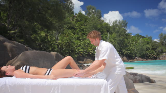 leg massage on the beach video
