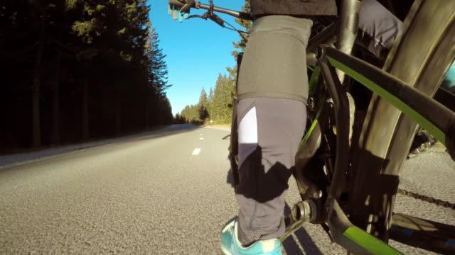POV Legs of a biker pedaling in sunshine video