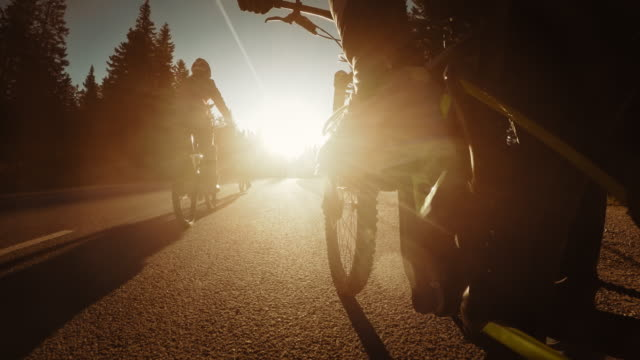 POV Legs of a biker riding into the sunset video