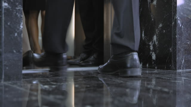 LD Legs of business people as they are entering the elevator video