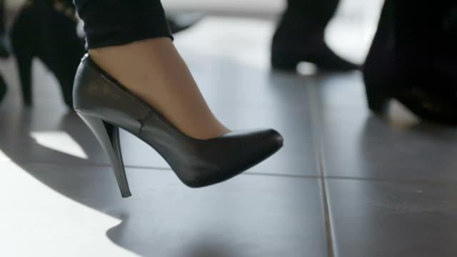 Legs of business people walking