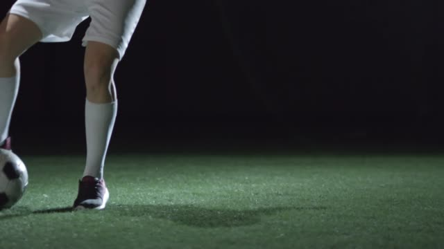 Legs of Female Athlete Dribbling Soccer Ball video