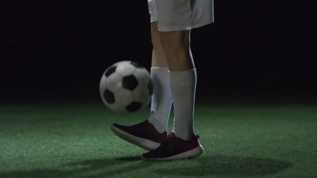 Legs of Female Soccer Player Juggling Ball video