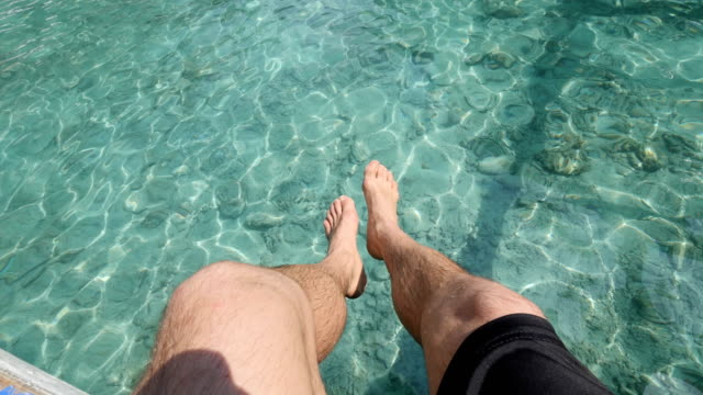 Legs of Man Chilling on a sailing boat in El Nido beaches