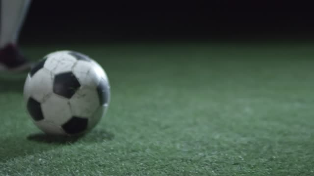 Legs of Professional Soccer Player Kicking Ball video