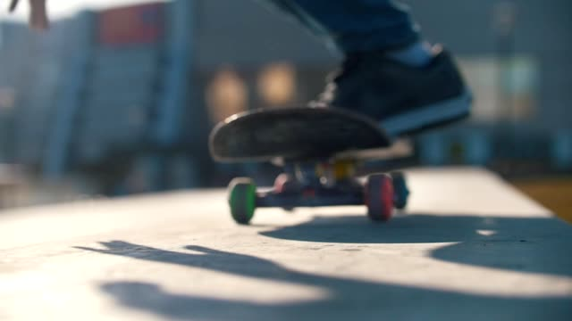 legs of skateboarder sliding on the ramp in sunny day - skateboard stock videos & royalty-free footage