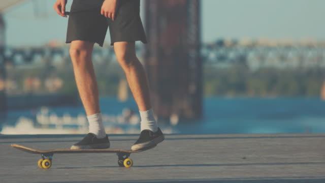 Legs of skater performing trick. video