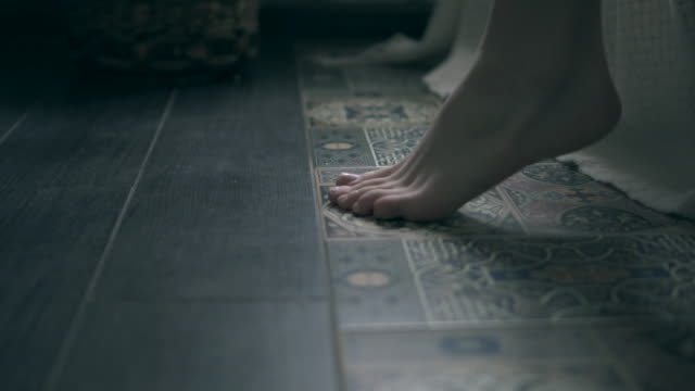 legs of woman touching floor in the morning after getting out bed - pajamas stock videos & royalty-free footage