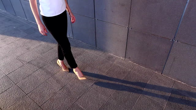 Legs on heels walking business video