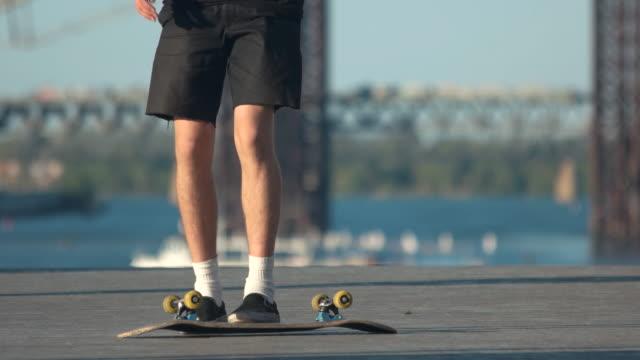 Legs performing a skate trick. video