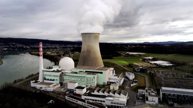 leibstadt nuclear plant approach - aerial 4k - reattore nucleare video stock e b–roll