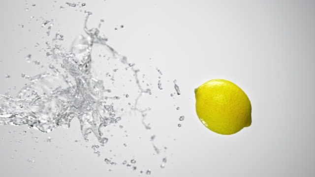 SLO MO Lemon being hit by a water splash in the air video