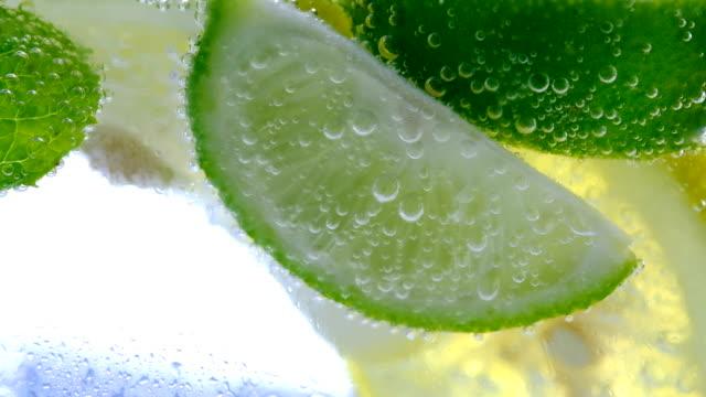 Lemon drop in fizzy sparkling water, juice refreshment video
