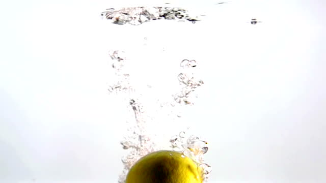 Lemon Falling Slow Motion In Clear Water video