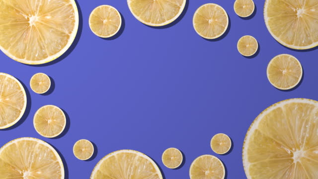 Lemon slice with copy space composition on purple background