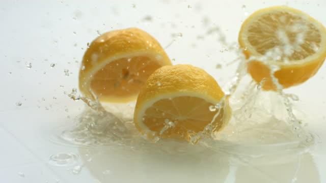 Lemons splashing, slow motion video