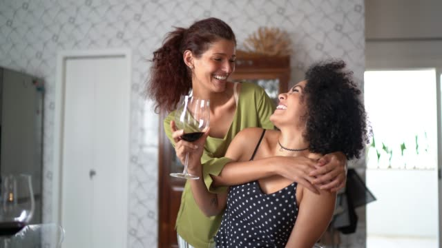 Lesbian Couple Drinking Wine Portrait at Kitchen