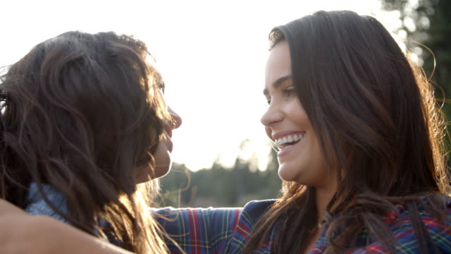 Lesbian couple embrace touching noses, eyes closed, close up Lesbian couple embrace touching noses, eyes closed, close up lesbian stock videos & royalty-free footage