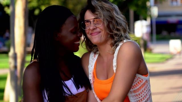 Lesbian couple having fun on the street Lesbian couple having fun on the street bisexuality stock videos & royalty-free footage